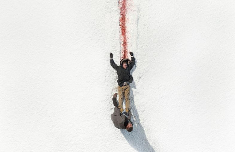 A dead body is dragged against white snow, promo pic for fargo season 2