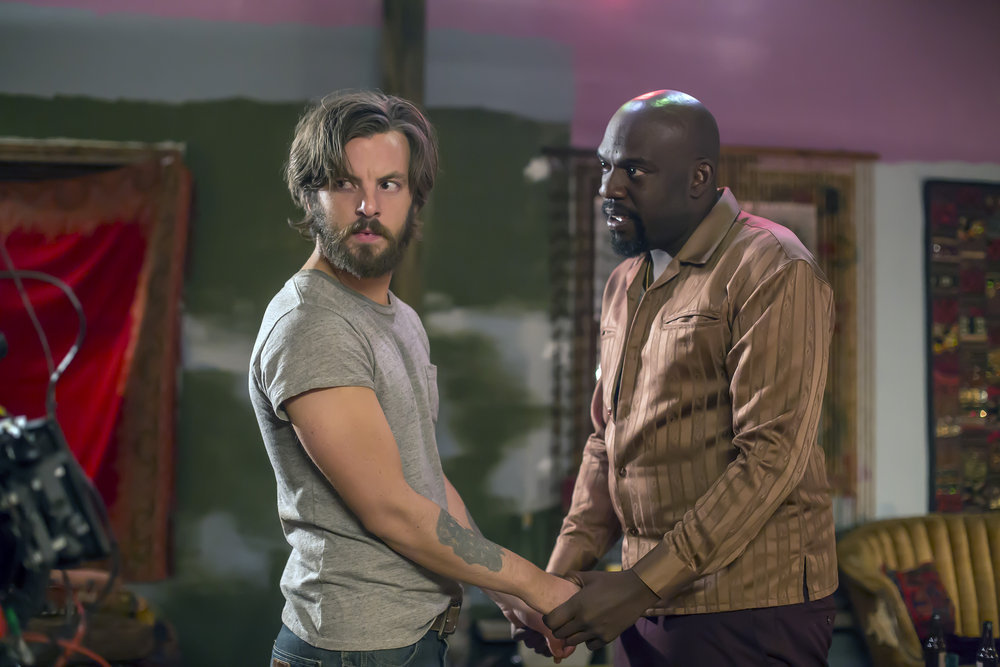 "AQUARIUS -- ""I'm So Tired"" Episode 201 -- Pictured: (l-r) Gethin Anthony as Charles Manson, Omar J. Dorsey as Ralph Church -- (Photo by: Ron Batzdorff/NBC)"