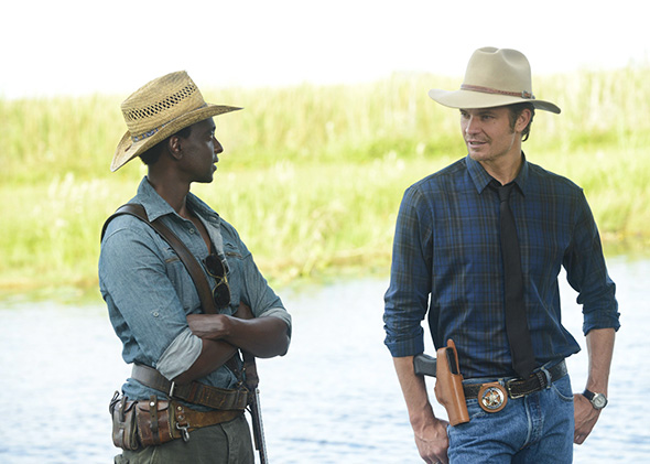 A Murder of Crowes -- Episode 501 (Airs Tuesday, January 7, 10:00 pm e/p) -- Pictured: (L-R) Edi Gathegi as Jean Baptiste, Timothy Olyphant as Deputy U.S. Marshal Raylan Givens